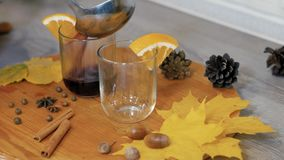 Mulled wine poured into a glass. Cooking traditional drink for Christmas. Mulled wine preparations. Close up stock video
