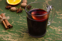 Mulled wine, punch and spices for glintwine on vintage wooden background Stock Photo