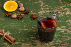 Mulled wine, punch and spices for glintwine on vintage wooden background Stock Image
