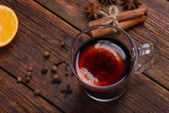 Mulled wine, punch and spices for glintwine on vintage wooden table background Royalty Free Stock Photo
