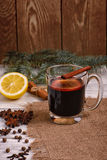 Mulled wine, punch and spices for glintwine on wooden background Stock Photography