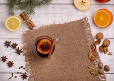 Mulled wine, punch and spices for glintwine on wooden background Royalty Free Stock Photos