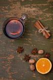 Mulled wine, punch and spices for glintwine on wooden background Royalty Free Stock Images
