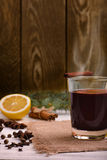 Mulled wine, punch and spices for glintwine on wooden background Royalty Free Stock Image