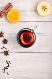 Mulled wine, punch and spices for glintwine on wooden background Stock Photos