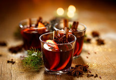 Mulled wine. Mulled red wine. A delicious and aromatic hot drink with the addition of oranges and spices. Mulled wine is often served at Christmas time Royalty Free Stock Image