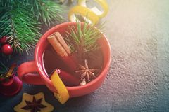 Mulled wine in red mugs and Christmas festive background Stock Photo