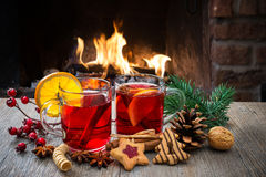 Mulled wine at romantic fireplace royalty free stock photography