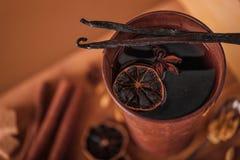 Mulled wine in the rustic metal mug Stock Photos