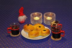 Mulled wine and saffron buns Stock Photography