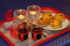 Mulled wine and saffron buns Royalty Free Stock Photography
