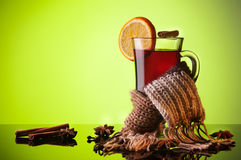 Mulled wine and scarf on green Royalty Free Stock Images