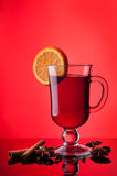 Mulled wine and scarf on red Royalty Free Stock Image