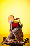 Mulled wine and scarf on yellow Stock Images