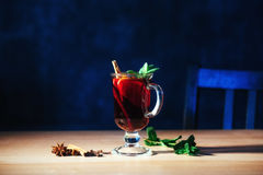 Mulled wine with slice of orange and spices. Shallow dof Stock Image