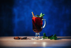 Mulled wine with slice of orange and spices. Shallow dof Stock Photography