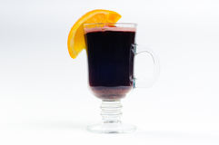 Mulled wine with slice of oranges anise and cinnamon. Isolated on white Royalty Free Stock Images
