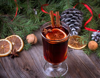 Mulled wine, sliced dried orange, cinnamon sticks Royalty Free Stock Photography