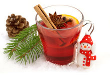 Mulled wine and small snowman Royalty Free Stock Images
