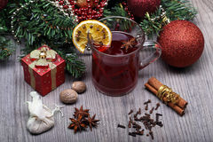 Mulled wine with spice and christmas decoration. Mulled wine with spices and christmas tree with decoration Stock Photos