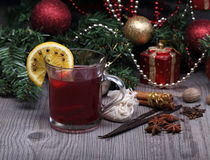 Mulled wine with spice and christmas tree Stock Image