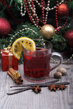 Mulled wine with spice and christmas tree Stock Images