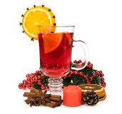 Mulled wine with spices and a candle Royalty Free Stock Photos