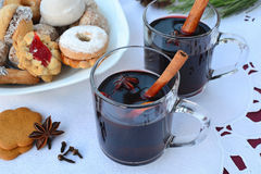 Mulled wine with spices and Christmas cookies. Shallow dof. stock photography