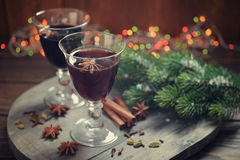 Mulled wine. With spices and christmas decoration on wooden background Royalty Free Stock Photography