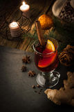 Mulled wine with spices and Christmas decorations vertical Royalty Free Stock Photo