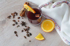 The mulled wine with spices, cinnamon stick and a slice of orange Stock Images