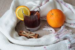 The mulled wine with spices, cinnamon stick and a slice of orange Royalty Free Stock Photo