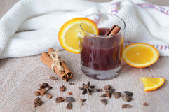 The mulled wine with spices, cinnamon stick and a slice of orange Royalty Free Stock Image