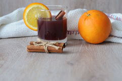 The mulled wine with spices, cinnamon stick and a slice of orange Royalty Free Stock Photography