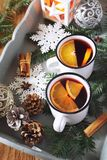 Mulled wine with spices and citrus fruit and burning lantern Royalty Free Stock Images