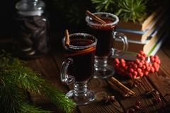 Mulled wine with spices and citrus fruit stock images