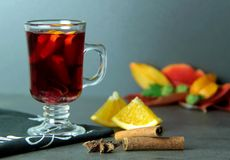 Mulled wine with spices and citrus fruits. Stock Photos