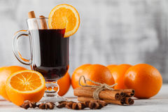 Mulled wine and spices closeup in glass cup. Homemade wine conce Royalty Free Stock Photo