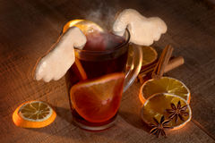 Mulled wine with spices and cookies Stock Image