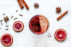 Mulled wine with spices in cup wooden background top view Stock Photo