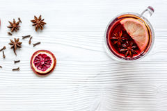 Mulled wine with spices in cup wooden background top view Royalty Free Stock Photos