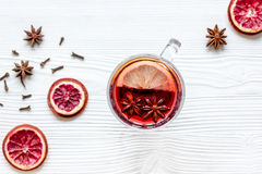 Mulled wine with spices in cup wooden background top view Stock Photography