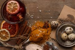 Mulled wine, spices and dried fruits on a rustic table royalty free stock photos