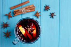 Mulled wine, spices and food decorations on bright background, t stock photos