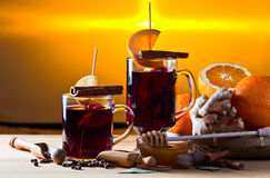 Mulled wine with spices and fruits Stock Images