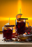 Mulled wine with spices and fruits Royalty Free Stock Images