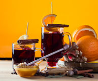 Mulled wine with spices and fruits Stock Photography