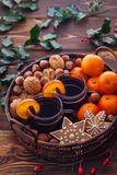 Mulled wine tangerines nuts Stock Images