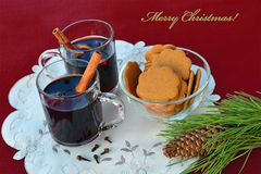 Mulled wine with spices and gingerbread cookies Stock Images