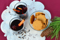 Mulled wine with spices and gingerbread cookies royalty free stock photo